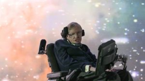 CAMBRIDGE -  Stephen Hawking in front of a galaxy projection.