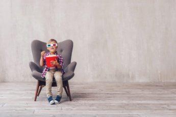 little-kid-with-popcorn-U483MSL